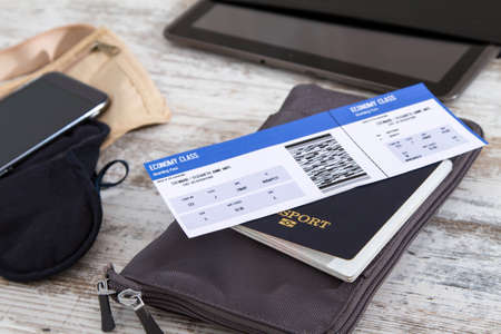 Foto de Airline ticket, passport and electronics, preparing to travel  - Imagen libre de derechos