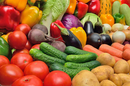 Crop of vegetables. Potatoes, peppers, tomatoes, cucumber, eggplant and other vegetables.
