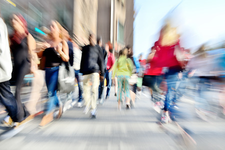 Foto per Zoom and motion blurred crowd crossing street. Blur effects made in lens, not post processing. - Immagine Royalty Free