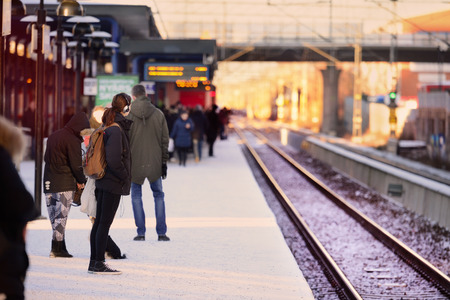 Foto per People waiting for the train, winter platform - Immagine Royalty Free