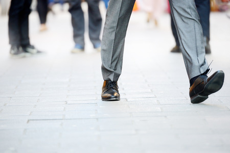 Foto per Business man in suit taking a big fast step forward - Immagine Royalty Free