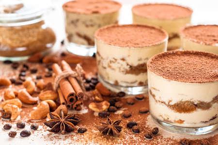 Photo pour Homemade tiramisu, traditional Italian dessert in glass on white wooden table - image libre de droit