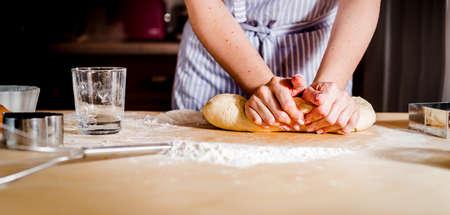 Foto de Female hands making dough for pizza kitchen accessories - Imagen libre de derechos