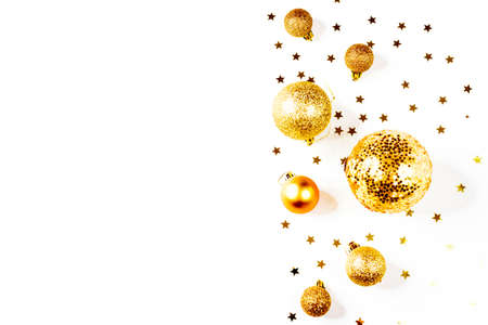 Photo pour Christmas composition. a pattern of golden christmas balls and stars from above. Flat lay, top view - image libre de droit