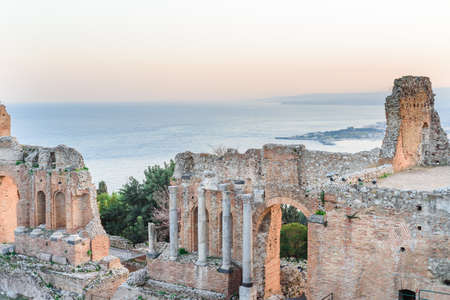 Photo for Greek reatre in Taormina Sicily, Italy, and Etna volcano in the background - Royalty Free Image