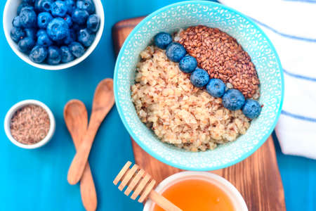 Photo for buckwheat porridge with fruits, the concept of a healthy breakfast, diet, veganism - Royalty Free Image