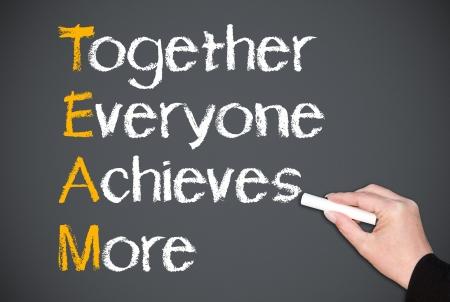 Foto de Together Everyone Achieves More - Team Concept - Imagen libre de derechos