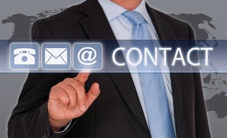 Photo pour Contact us - Businessman with touchscreen - image libre de droit