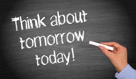 Foto de Think about tomorrow today! written on blackboard - Imagen libre de derechos