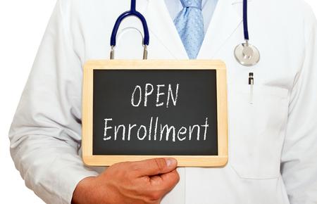 Photo pour Open Enrollment - Doctor with chalkboard - image libre de droit