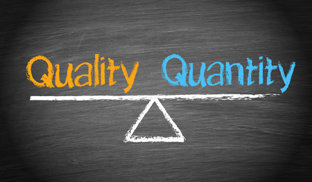 Foto de Quality and Quantity - Balance Concept - Imagen libre de derechos