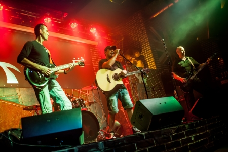 Photo for Band performs on stage, rock music - Royalty Free Image