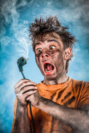 Foto de Boy has a electric shock - Imagen libre de derechos
