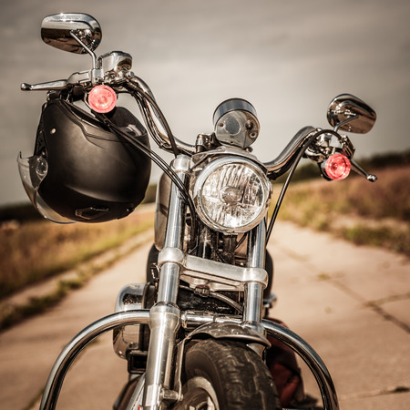 Photo pour Motorcycle on the road with a helmet on the handlebars. - image libre de droit