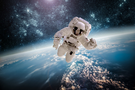 Foto de Astronaut in outer space against the backdrop of the planet earth. Elements of this image furnished by NASA. - Imagen libre de derechos