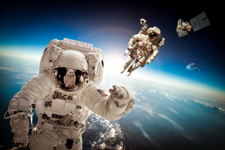Photo for Astronaut in outer space against the backdrop of the planet earth. Elements of this image furnished by NASA. - Royalty Free Image