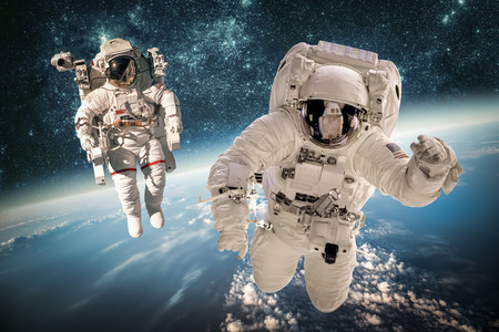 Photo pour Astronaut in outer space against the backdrop of the planet earth. Elements of this image furnished by NASA. - image libre de droit