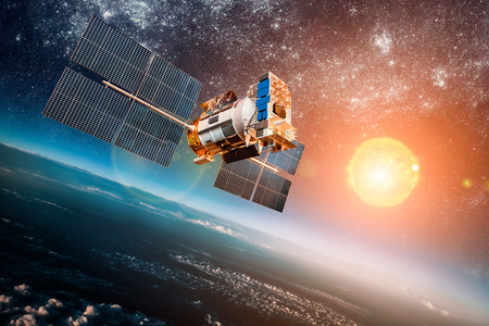 Photo pour Space satellite orbiting the earth on a background star sun. Elements of this image furnished by NASA. - image libre de droit
