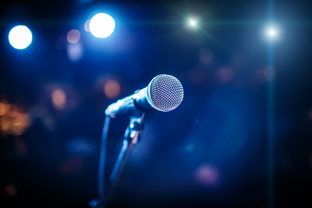 Photo for Microphone on stage against a background of auditorium - Royalty Free Image