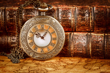Foto de Vintage Antique pocket watch on the background of old books - Imagen libre de derechos