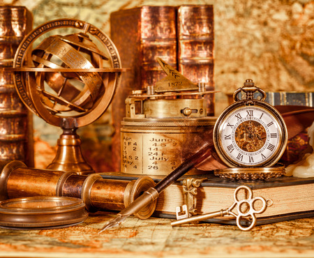 Photo pour Vintage book, compass, telescope and a pocket watch lying on ancient world map in 1565. - image libre de droit
