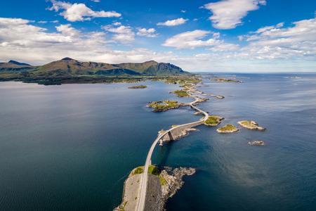 Foto de Atlantic Ocean Road or the Atlantic Road (Atlanterhavsveien) been awarded the title as Norwegian Construction of the Century. The road classified as a National Tourist Route. Aerial photography - Imagen libre de derechos