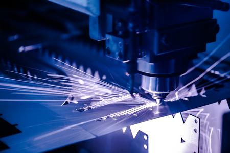 Foto de CNC Laser cutting of metal, modern industrial technology. Small depth of field. Warning - authentic shooting in challenging conditions. - Imagen libre de derechos