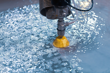 Foto per CNC water jet cutting machine modern industrial technology. - Immagine Royalty Free