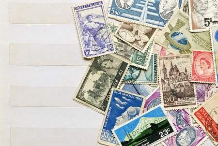 Foto de Used stamps mail of  different countries on the book collecting stamps page. - Imagen libre de derechos