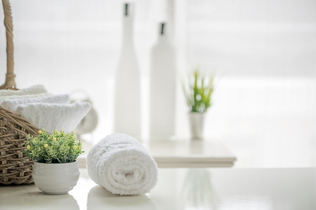 Photo pour White towels on white table with copy space on blurred bathroom background. For product display montage. - image libre de droit
