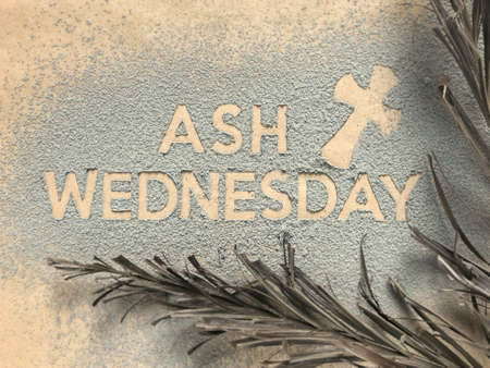 Photo for Ash Wednesday concept - Ash Wednesday words and a cross formed out of ashes. There are dry palm leaves on the sides. - Royalty Free Image