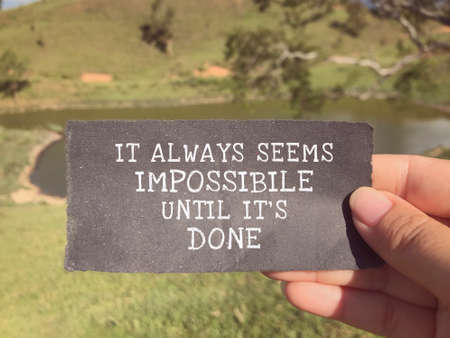 Photo for Motivational and inspirational wording - It Always Seems Impossible Until It's Done written on a ripped paper. - Royalty Free Image