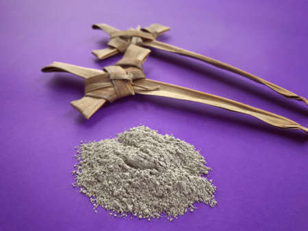 Photo for Good Friday, Palm Sunday, Ash Wednesday, Lent Season and Holy Week concept.  A Christian crosses made of palm leaf and ashes on purple background. - Royalty Free Image