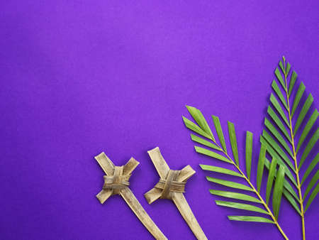 Photo for Good Friday, Lent Season, Ash Wednesday, Palm Sunday and Holy Week concept. Crosses made of palm leaves and palm leaves on purple background. - Royalty Free Image