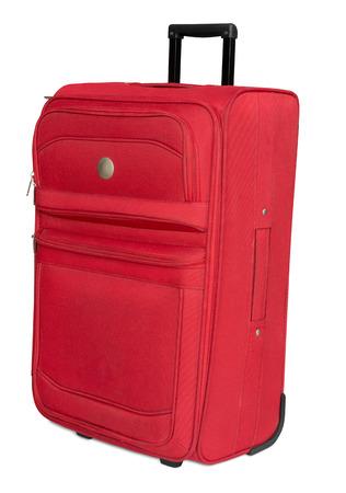 Foto de Red textile suitcase isolated on white - Imagen libre de derechos