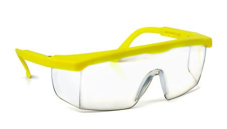Foto de Plastic safety goggles isolated on white - Imagen libre de derechos