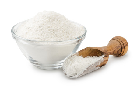 Photo for Wheat flour in bowl and scoop isolated on white - Royalty Free Image