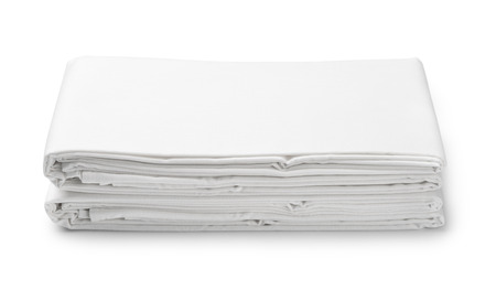 Photo pour Stack of white folded bedding sheets isolated on white - image libre de droit