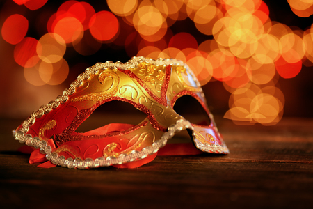 Photo for Traditional carnival mask over holiday lights  background - Royalty Free Image