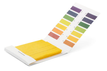 Foto de Litmus PH test strips and color samples isolated on white - Imagen libre de derechos