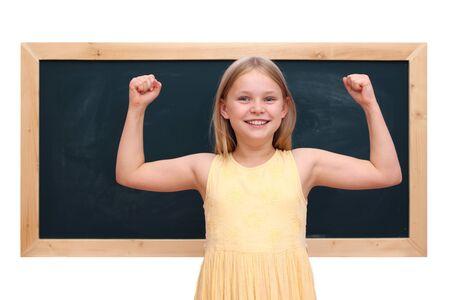 Schoolgirl infront of the blackboard