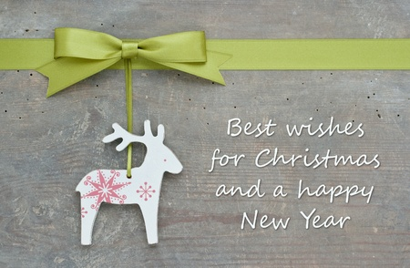 Photo for christmas card with reindeer and green bow - Royalty Free Image