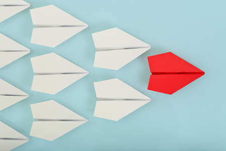 Photo for red paper plane leading white ones, leadership concept - Royalty Free Image