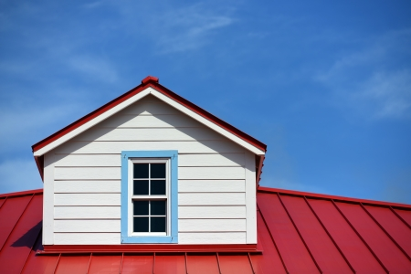 Close up a red roof detail house and a blue sky
