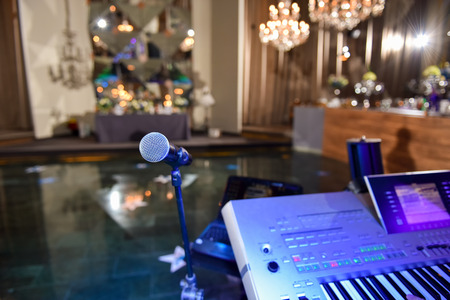 Photo for Microphone and electronic organ in ambient light bar - Royalty Free Image