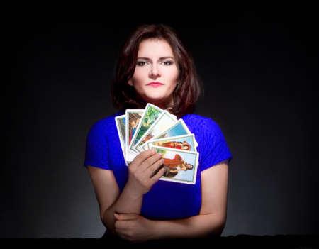 Photo pour Woman in Blue Dress Holding Tarot Cards - image libre de droit