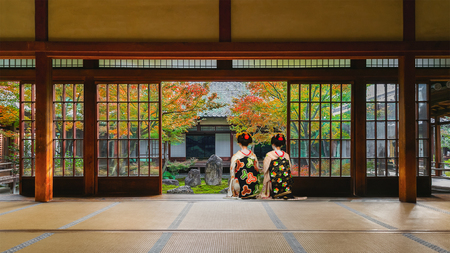 Photo for Japanese Geisha at Look at a Japanese Garden in Colorful Autumn at Kenninji Temple in Kyoto - Royalty Free Image