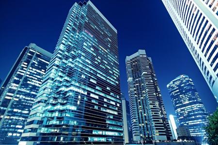 Foto de Tall office buildings by night  - Imagen libre de derechos