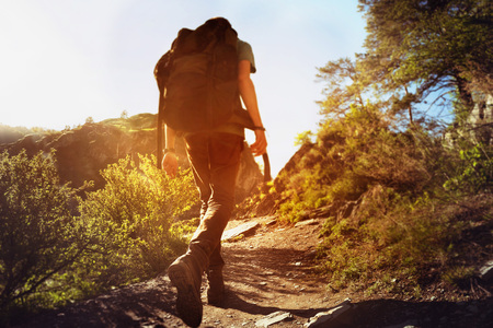 Photo for Man goes on trek uphill - Royalty Free Image