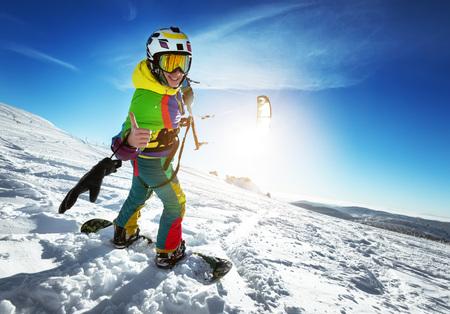 Photo pour Happy lady snowboarder with snow kite - image libre de droit